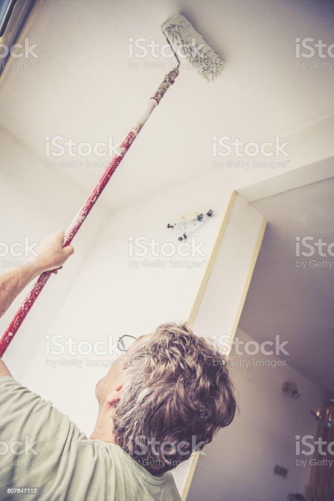 Portrait of caucasian senior man with eyeglasses. Home renovation,...