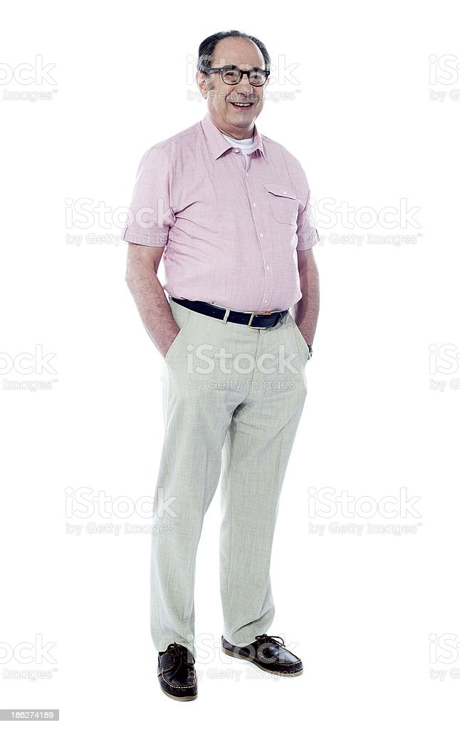 Senior man posing casually, full length portrait royalty-free stock photo