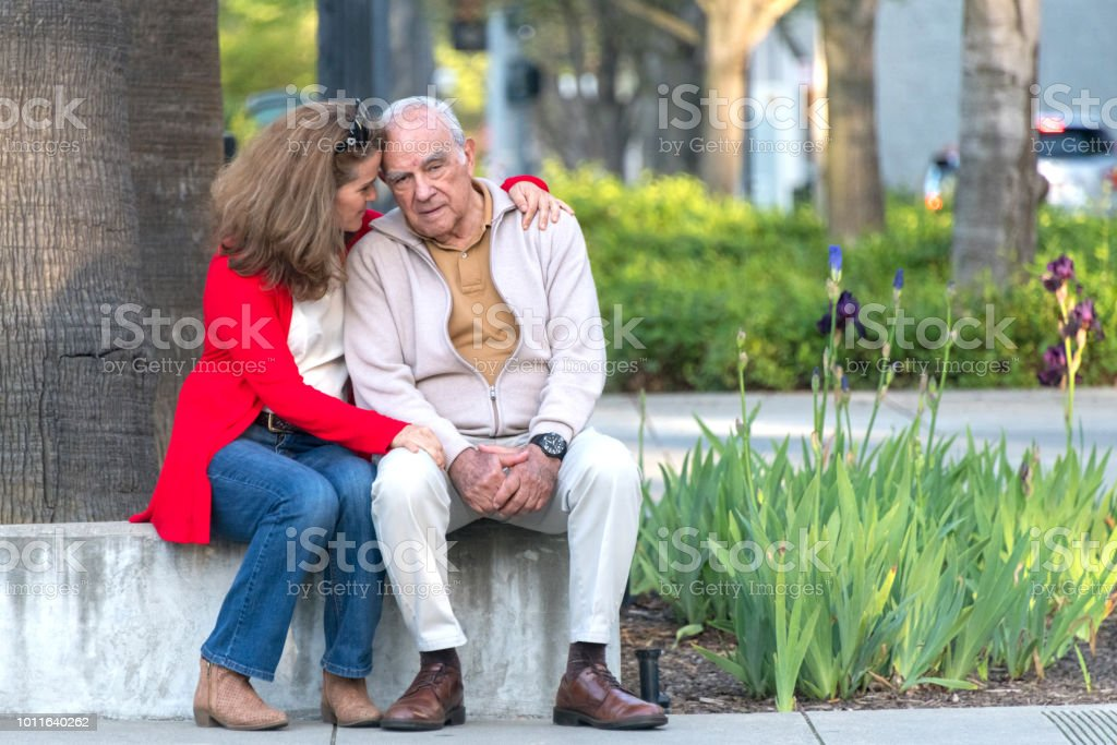 senior man possing with his daughter stock photo