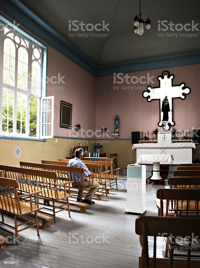 Senior man praying in a country chapel royalty-free stock photo