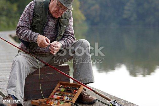 istock Senior man preparing the bait for fishing 522644787