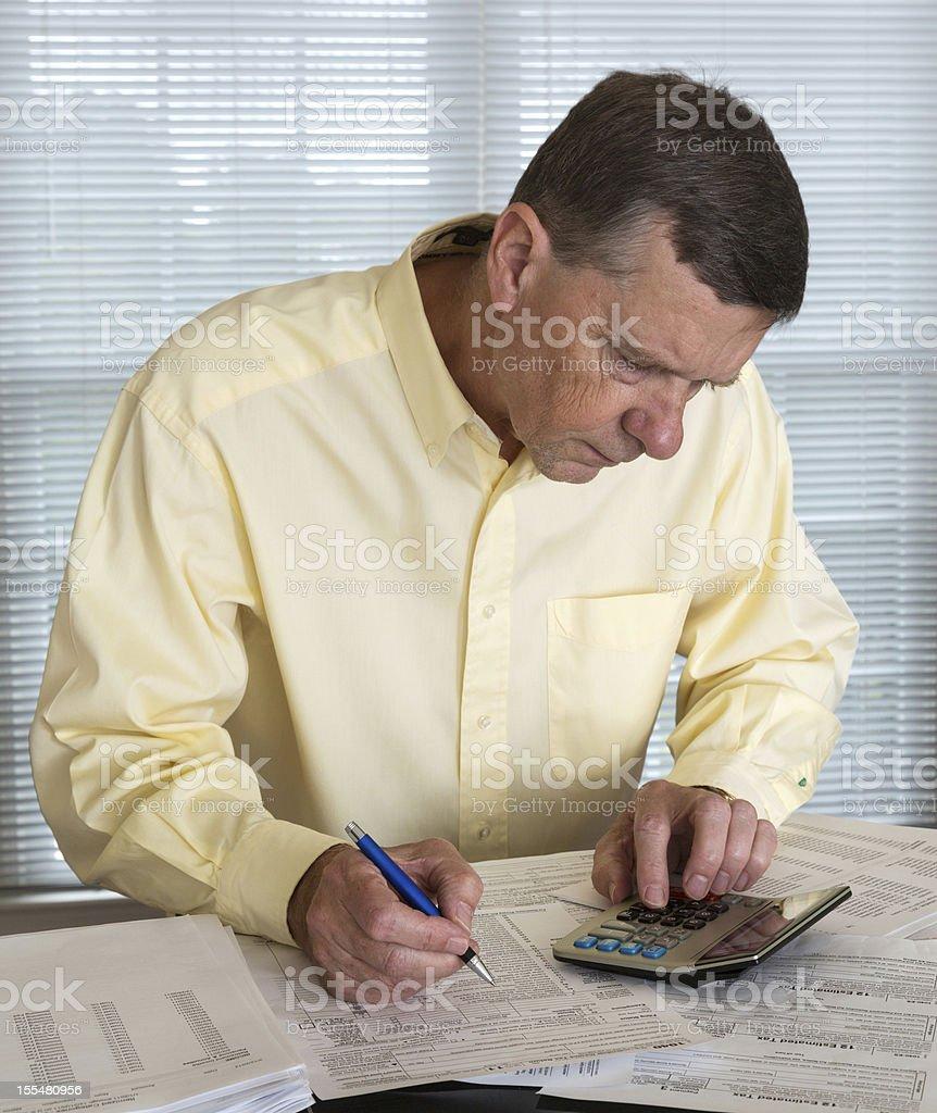 Senior man preparing USA tax form 1040 for 2012 royalty-free stock photo