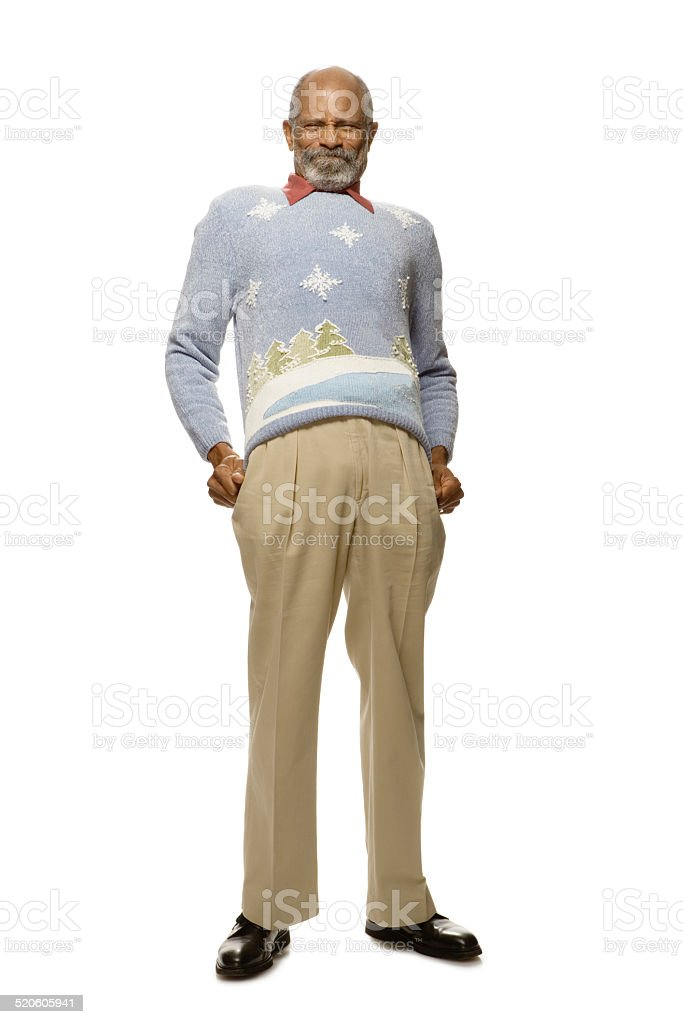 Senior man pulling sweater down, close-up stock photo