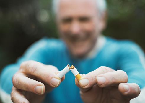 Senior man gives up the smoking habit.