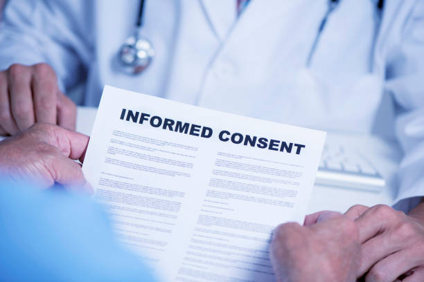 senior man reading an informed consent - permit stock photos and pictures