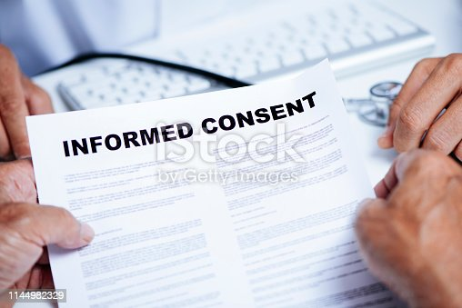 istock senior man reading an informed consent 1144982329