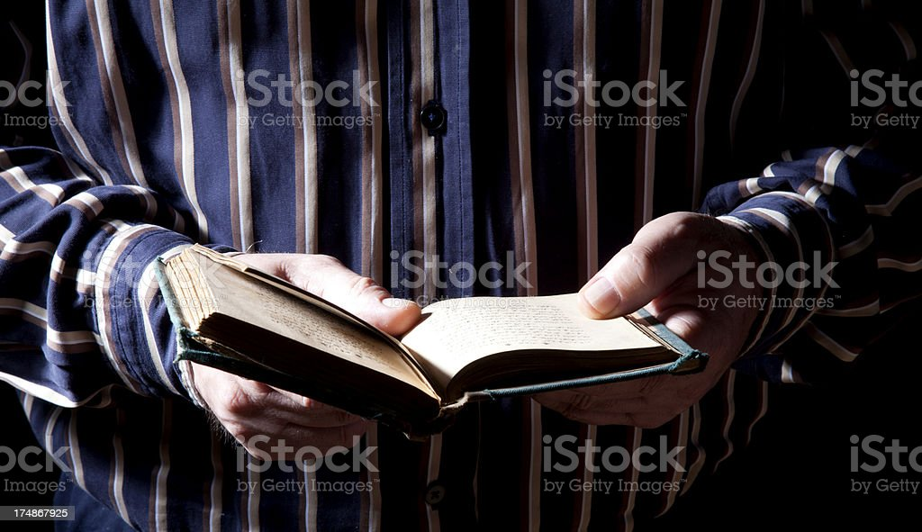 senior man reading book royalty-free stock photo