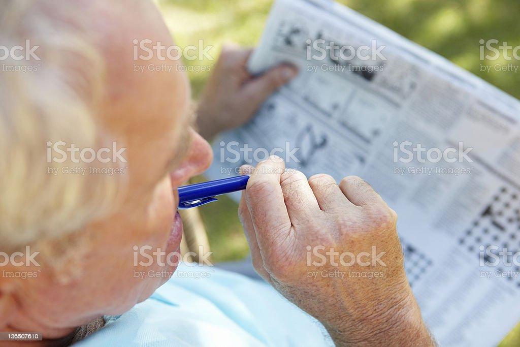 Senior man reading newspaper stock photo