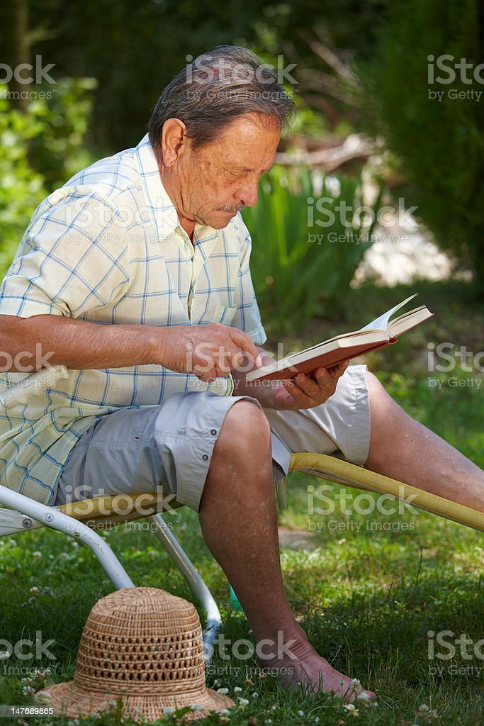 Senior Man Reading Outdoor royalty-free stock photo