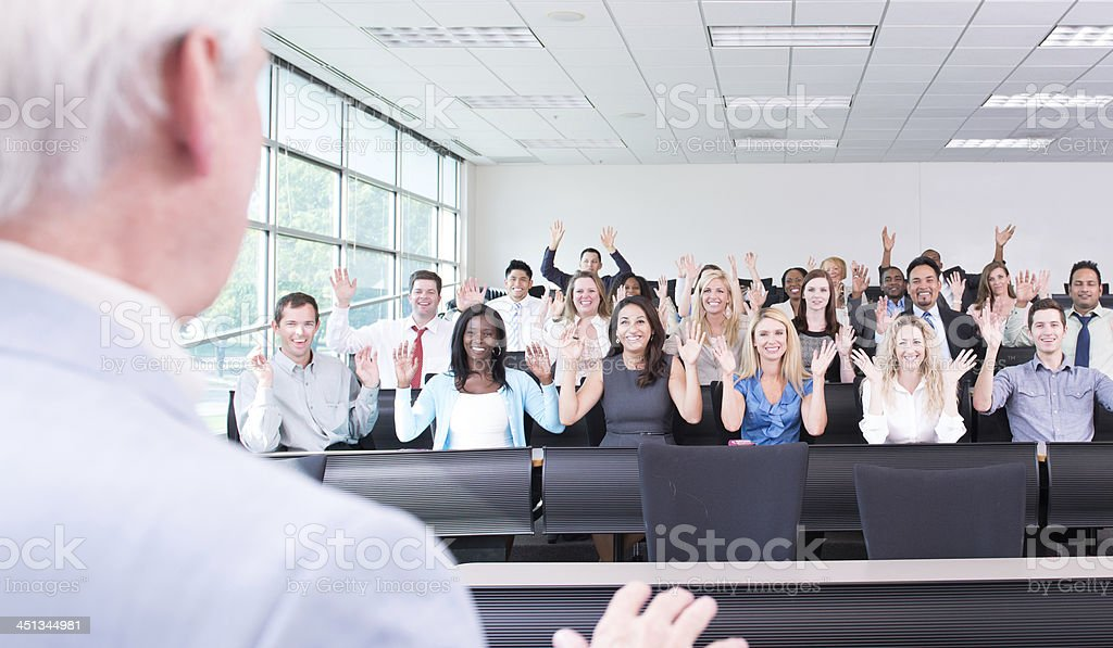 Senior Man receiving Applause from Deaf Lecture stock photo
