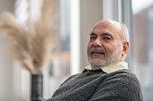 istock Senior man relaxing at home 1292656700