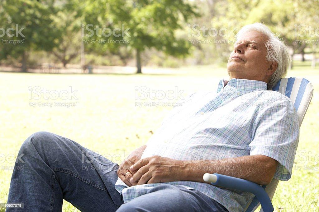Senior Man Relaxing In Park royalty-free stock photo