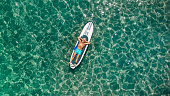 istock Senior man relaxing on a paddleboard 1194452074