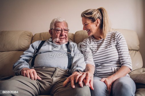 istock Senior Man Relaxing with his Daughter 665805064