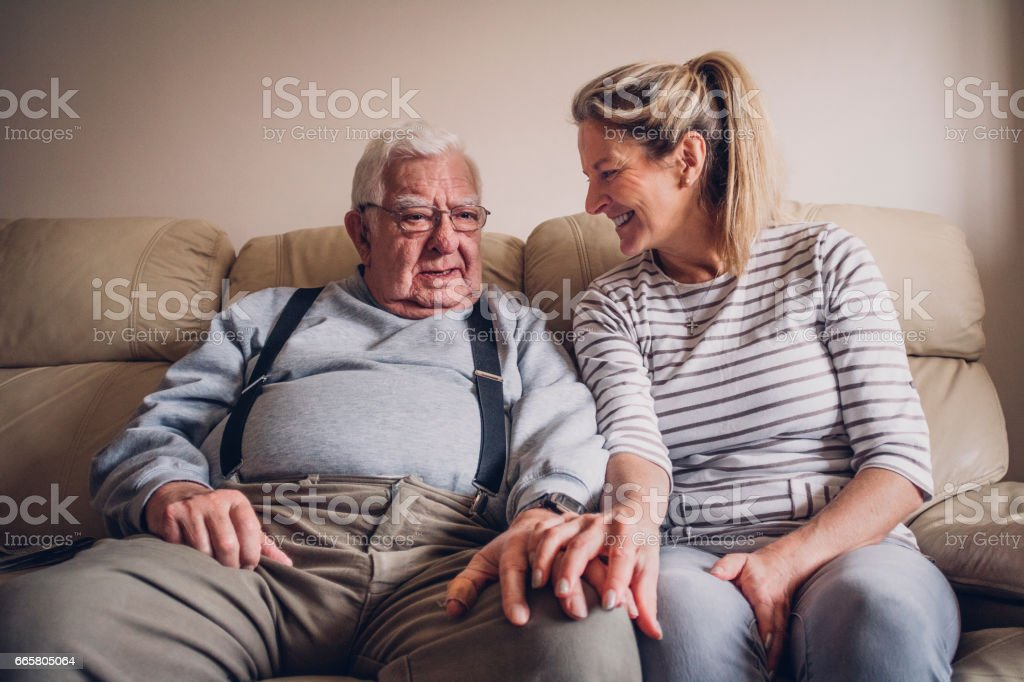 Senior Man Relaxing with his Daughter stock photo