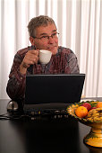 istock Senior man resting at laptop with cup-of-coffee 172202861