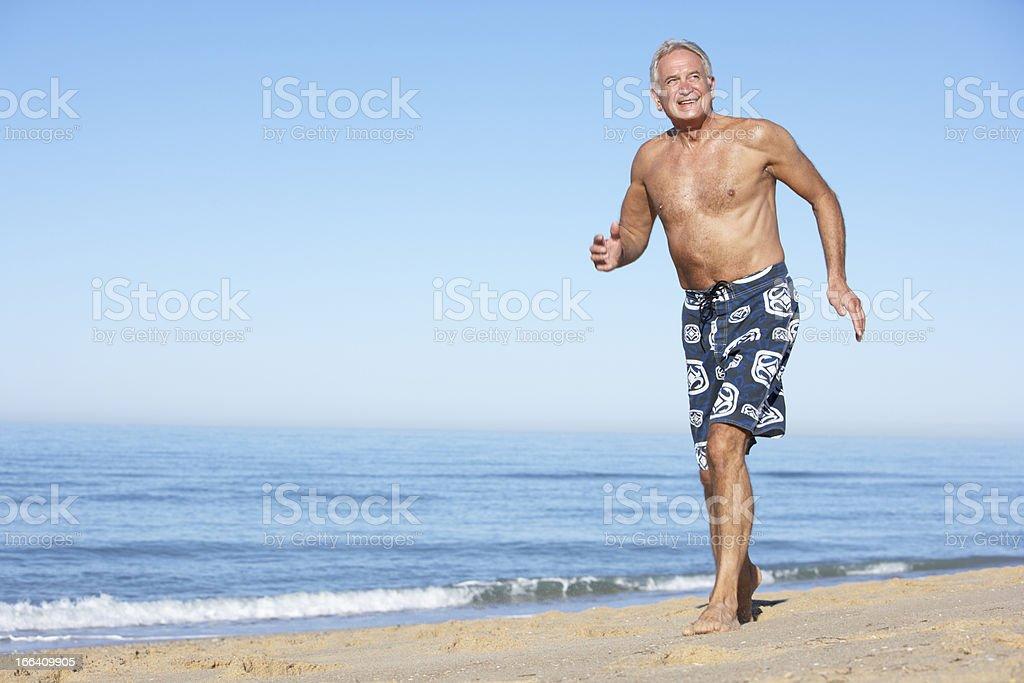 Senior Man Running Along Summer Beach royalty-free stock photo