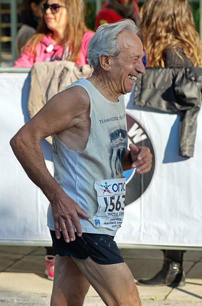 Senior Man runs the Athens Marathon stock photo