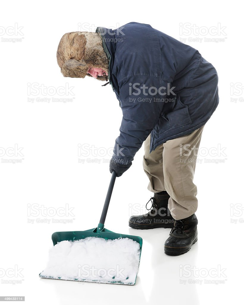 Senior Man Scooping Up Snow stock photo
