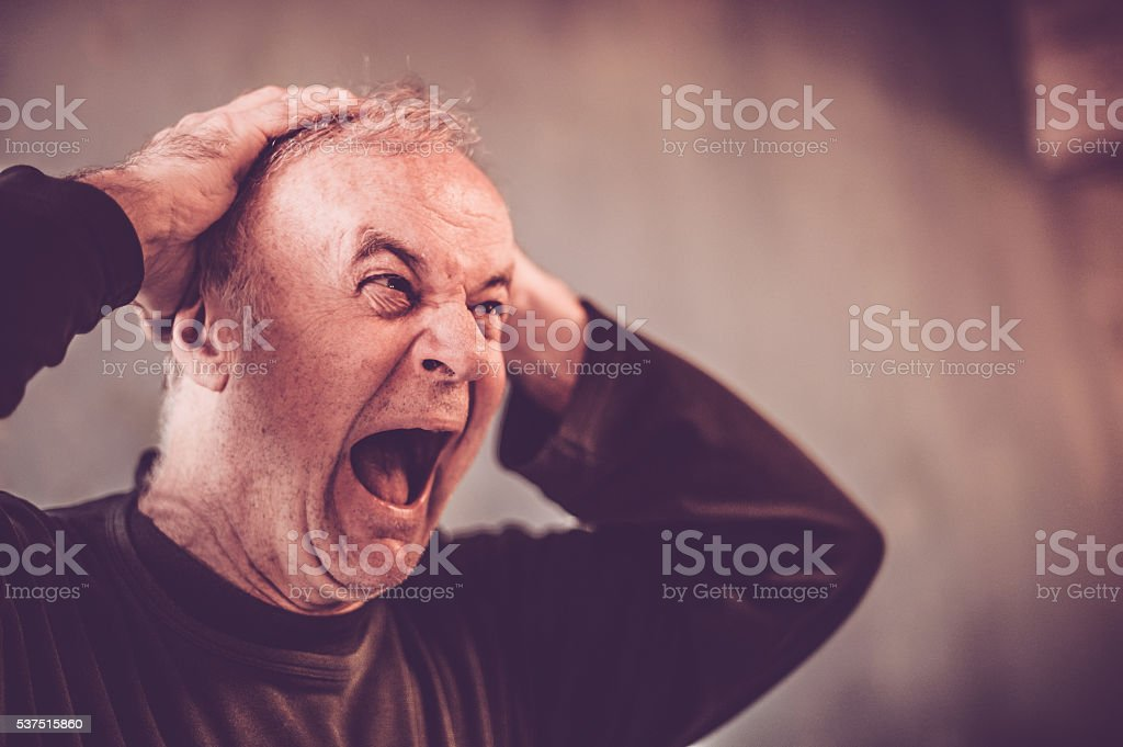 Senior man screaming stock photo