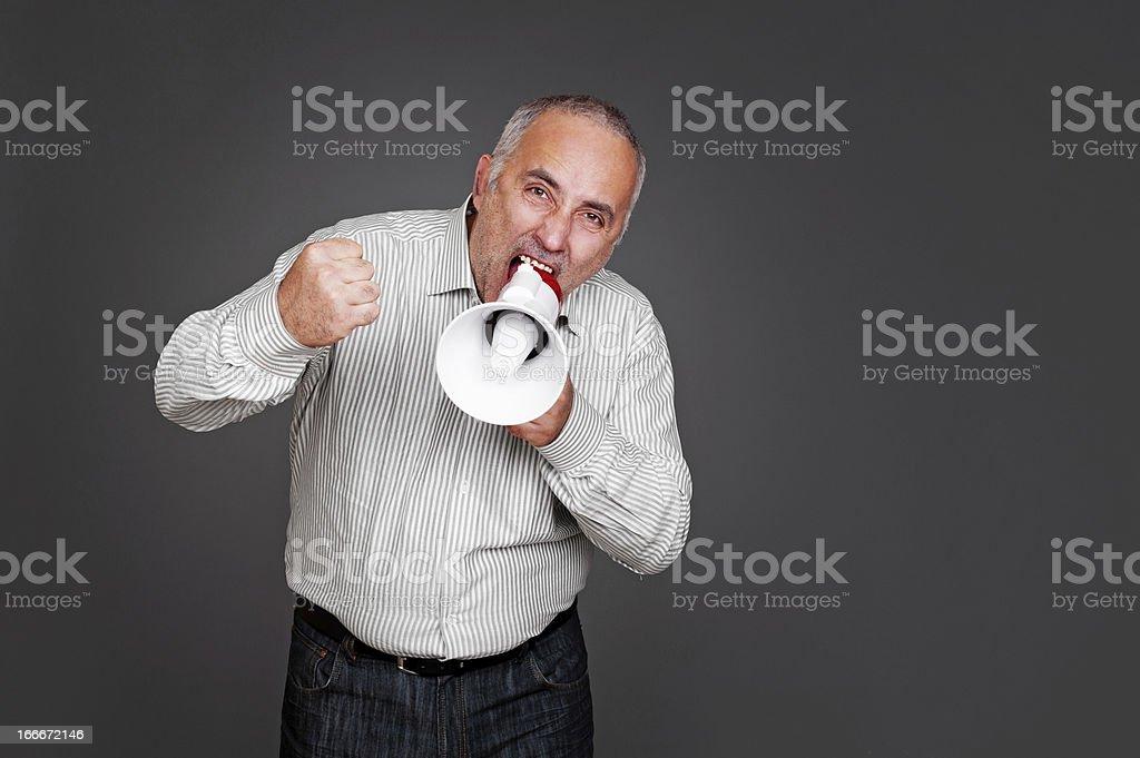 senior man shouting with megaphone royalty-free stock photo