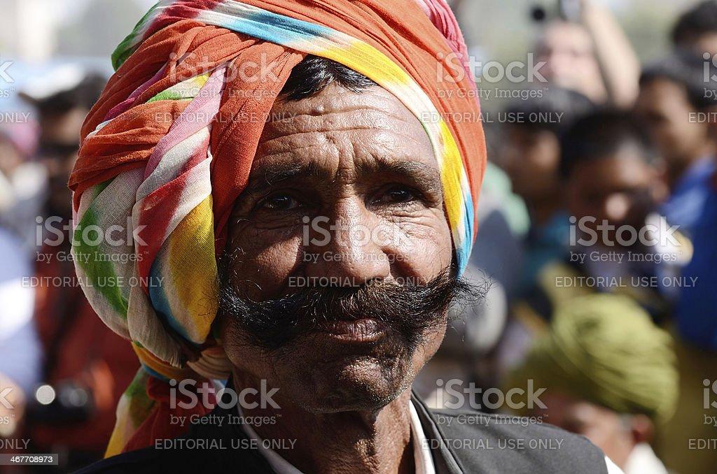 Senior man shows his moustache  at camel fair,Rajasthan,India stock photo