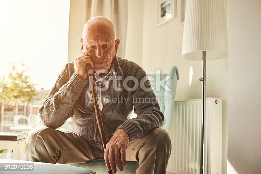 istock Senior man sitting alone at home 912073236