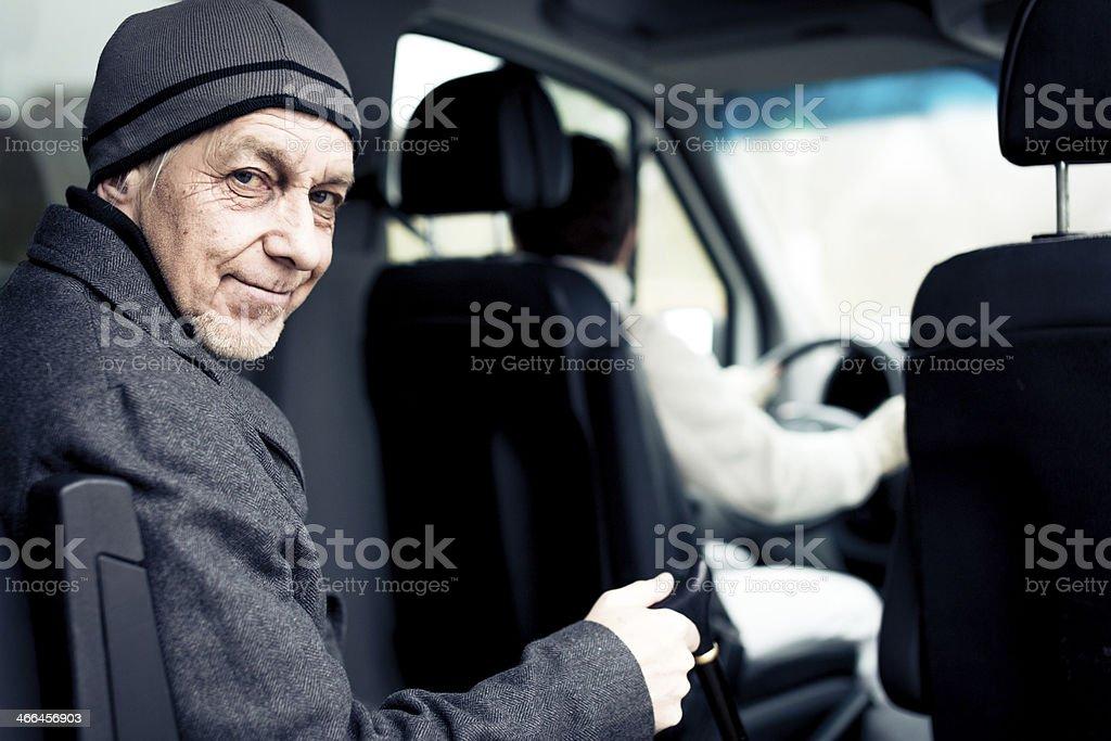 senior man sitting in paratransit van stock photo