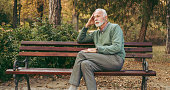 Senior man sitting on bench in the park