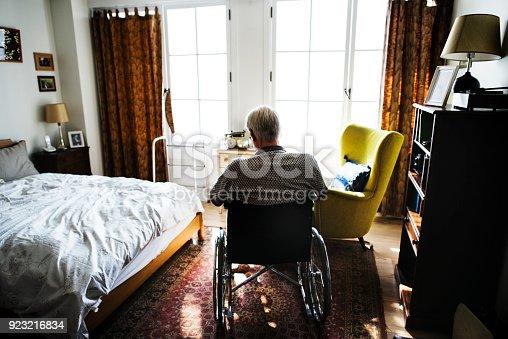 istock Senior man sitting on the wheelchair alone 923216834