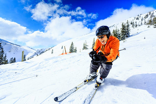 senior man skiing stock photo