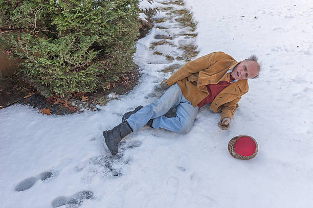 senior man slipping on ice on his walkway - old man feet stock photos and pictures