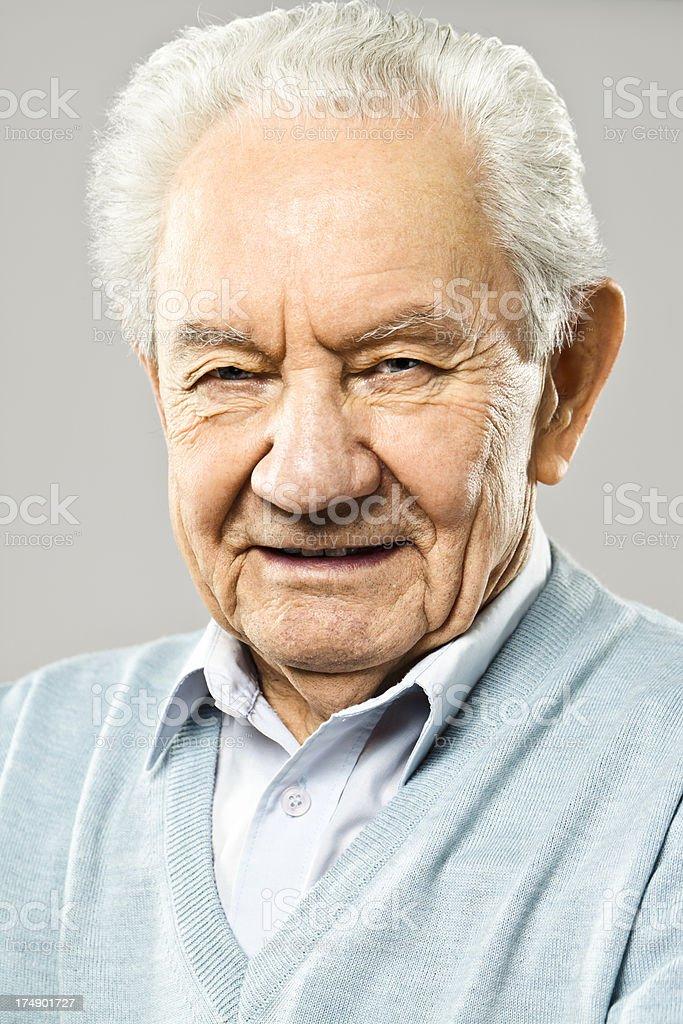 Senior man smiling at camera royalty-free stock photo
