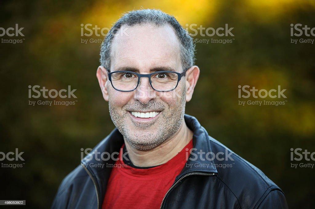 Senior Man Smiling At The Camera stock photo
