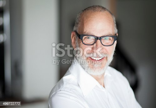 istock Senior Man Smiling At The Camera 499722772