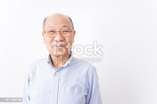 Senior man smiling on white background