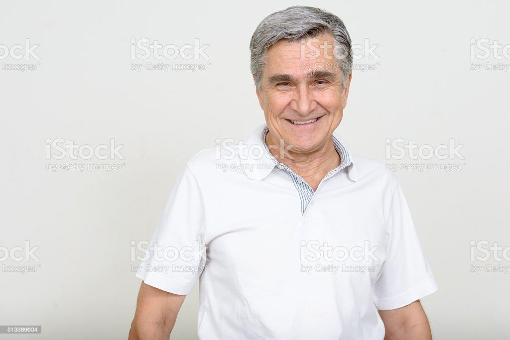 Senior man smiling stock photo