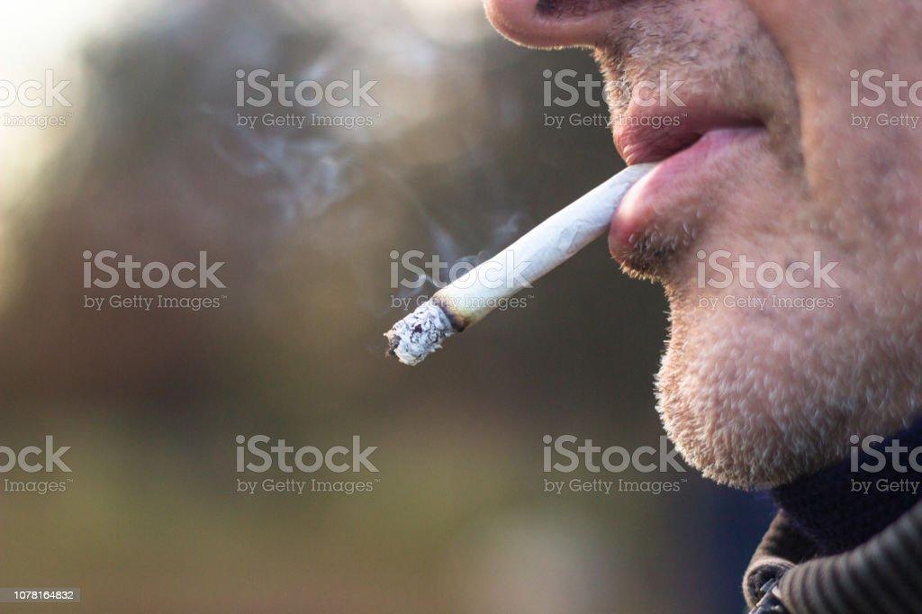 Senior man Smoking stock photo