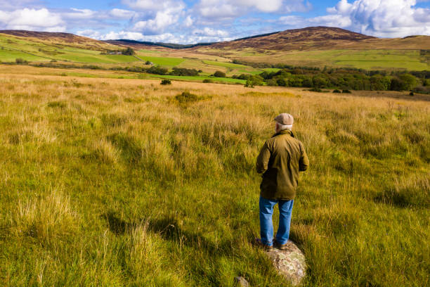 Senior man standing in the countryside of Dumfries and Galloway stock photo