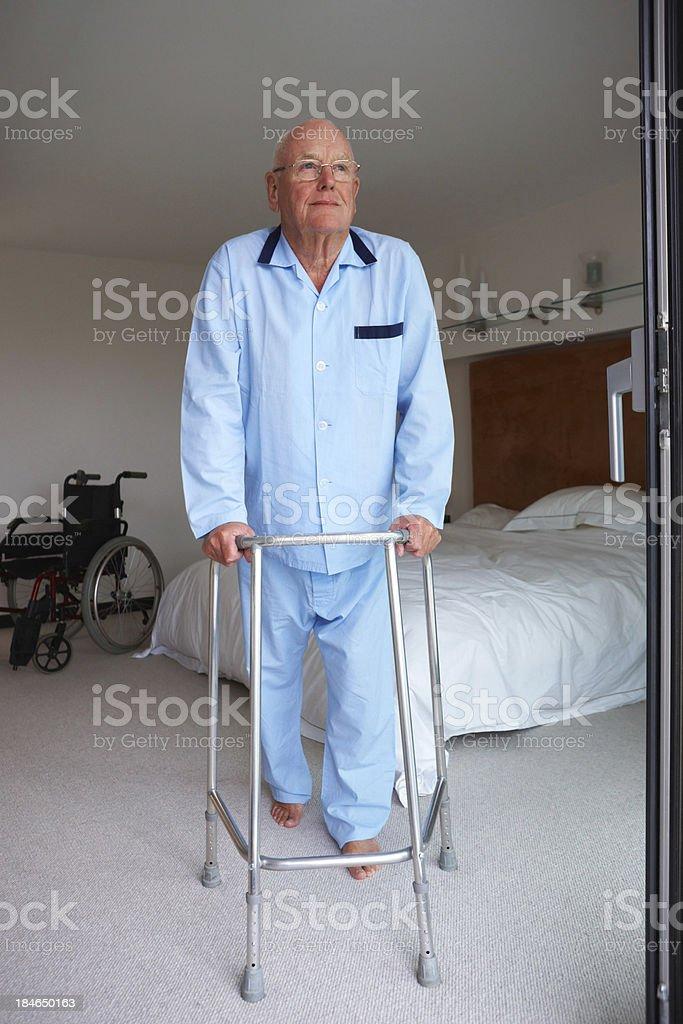 Senior Man Standing With a Walker royalty-free stock photo