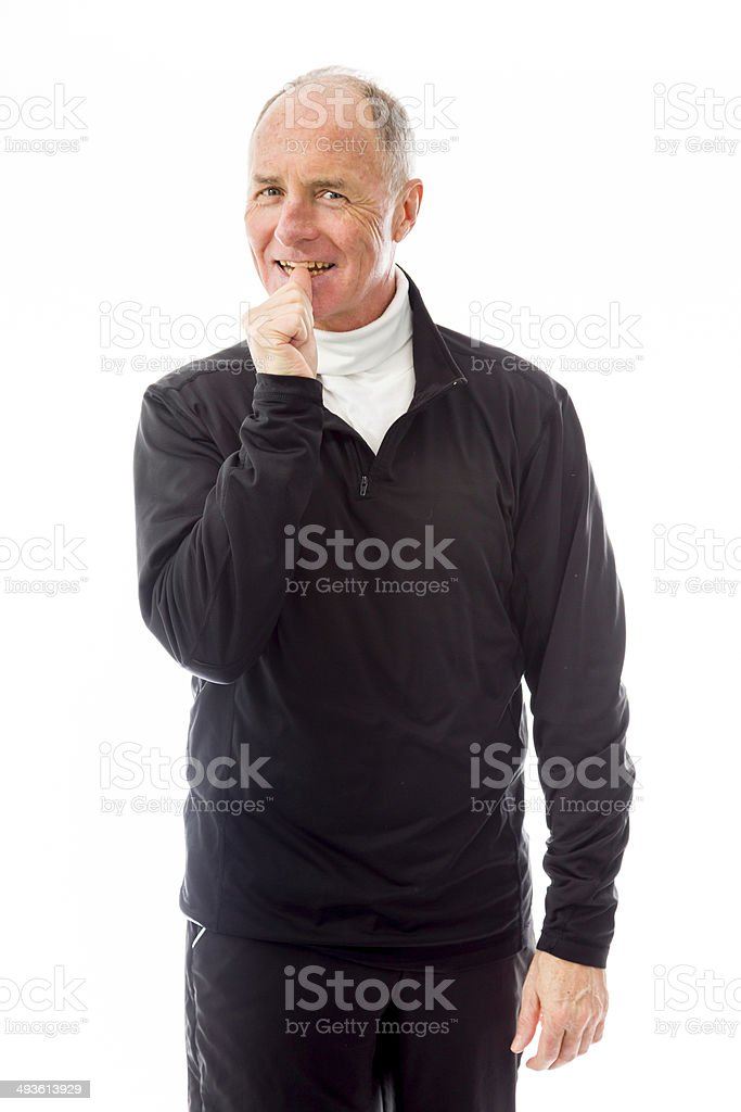 Senior man standing with finger in mouth royalty-free stock photo