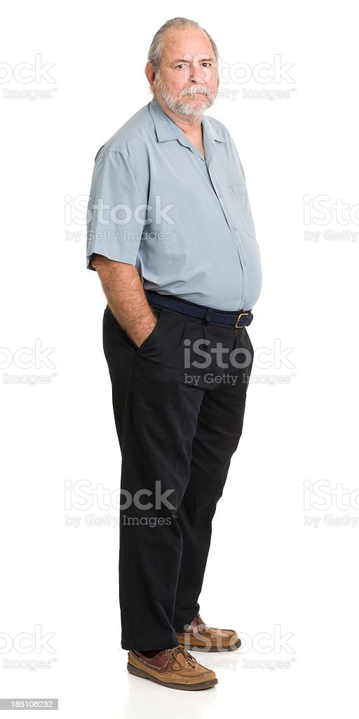 Senior Man Standing With Hands In Pockets stock photo