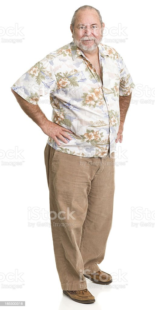 Senior Man Standing With Hands On Hips stock photo