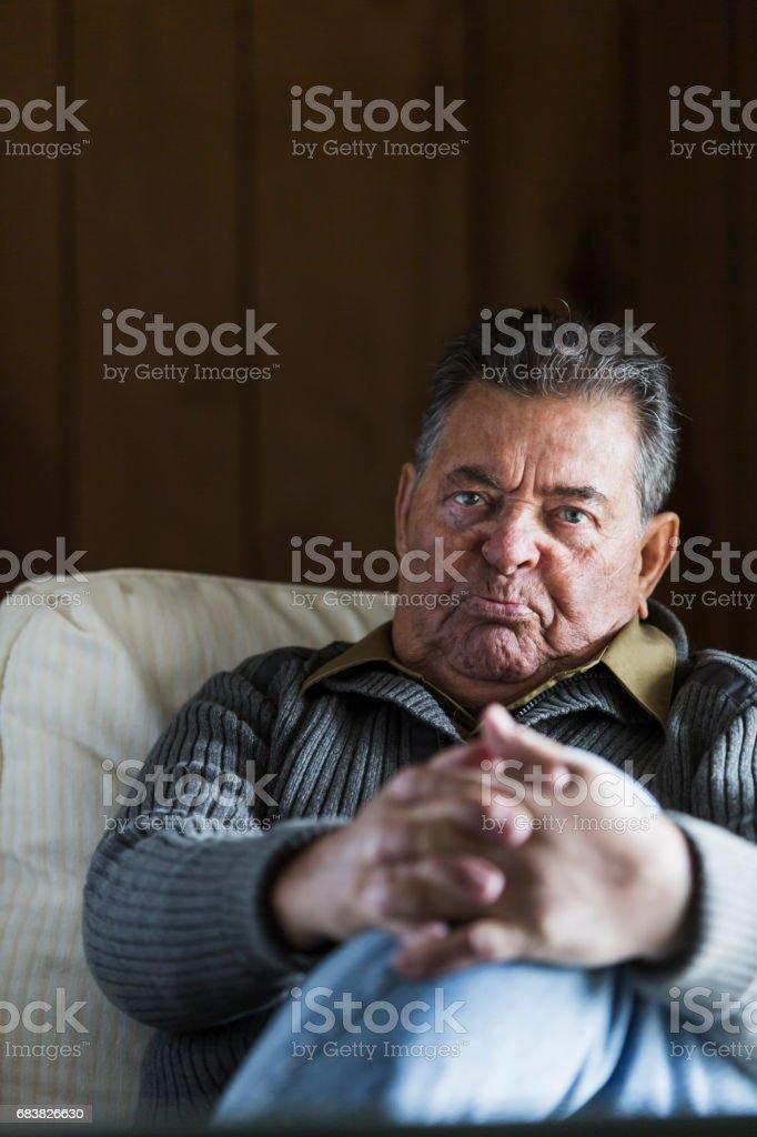 Senior man staring at camera stock photo