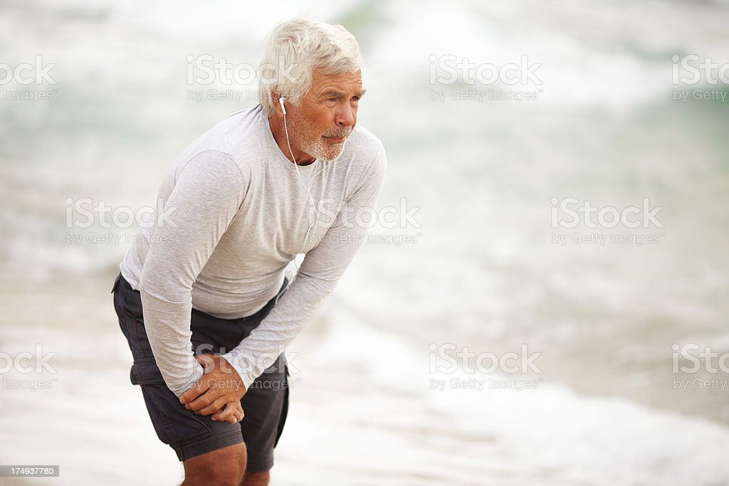 Senior man streching royalty-free stock photo