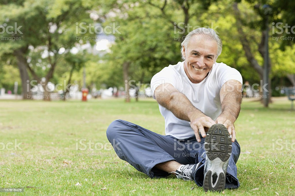 Senior Man Stretching in the Park royalty-free stock photo