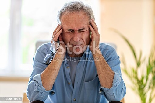 1162960006 istock photo Senior man suffering from a headache 1253815310
