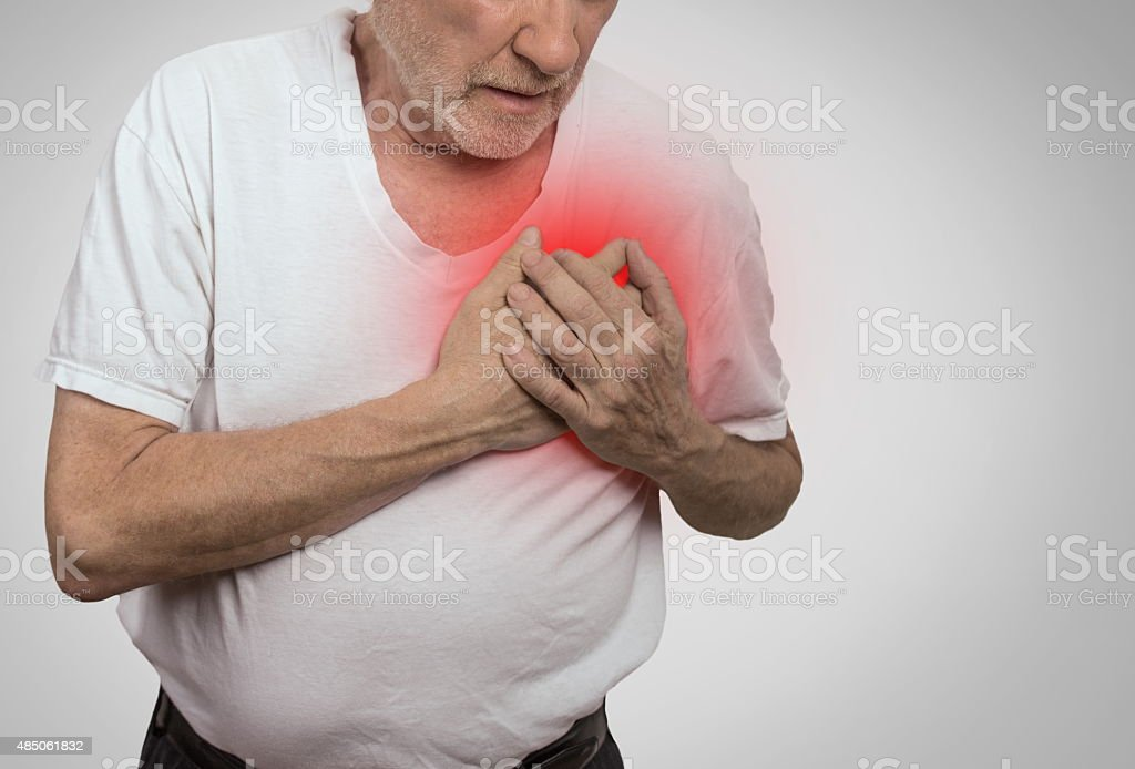 senior man suffering from bad pain in his chest stock photo