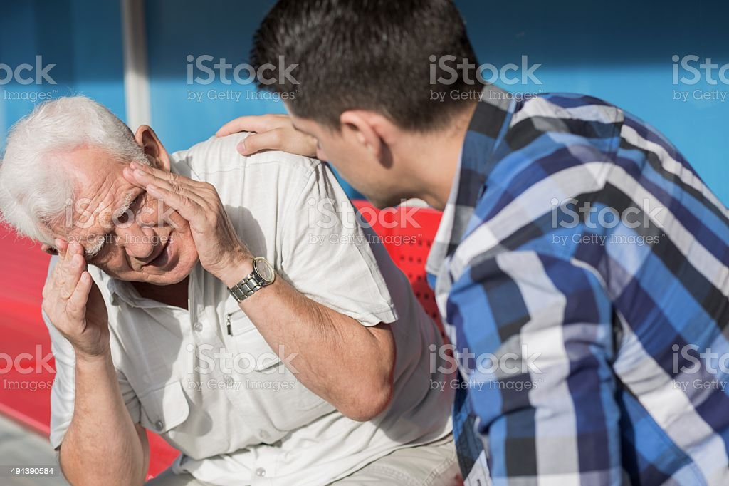 Senior man suffering from dizziness stock photo