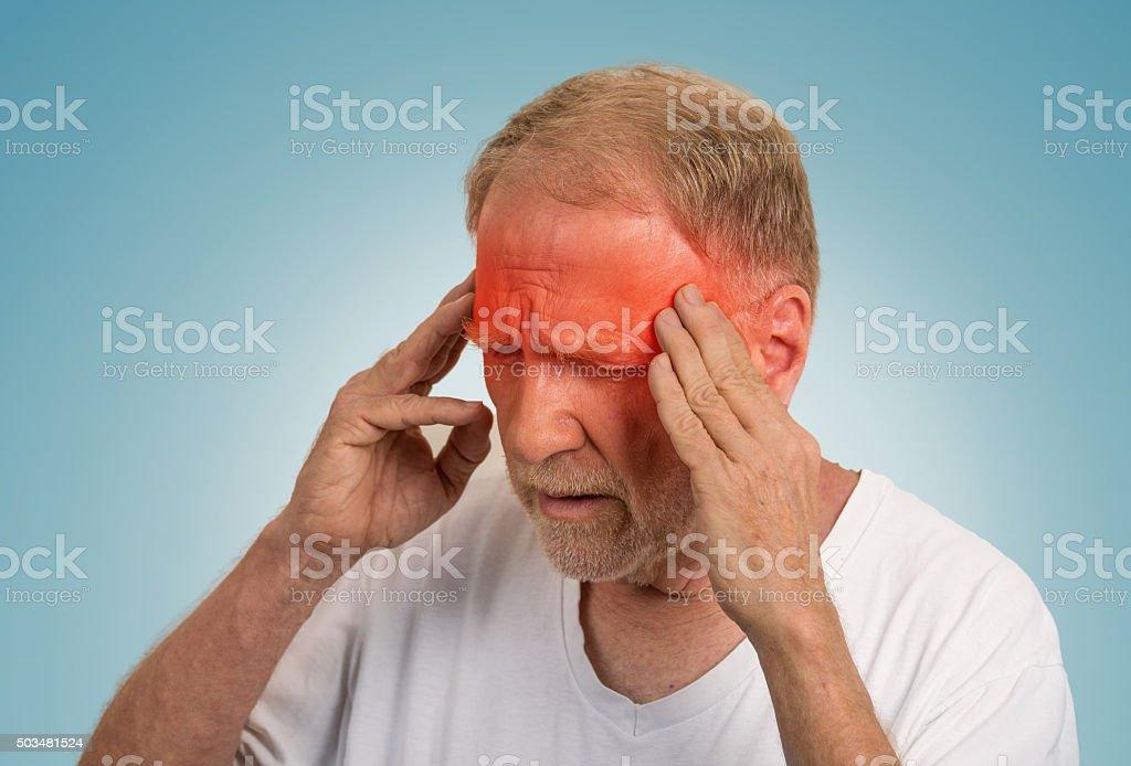 senior man suffering from headache stock photo